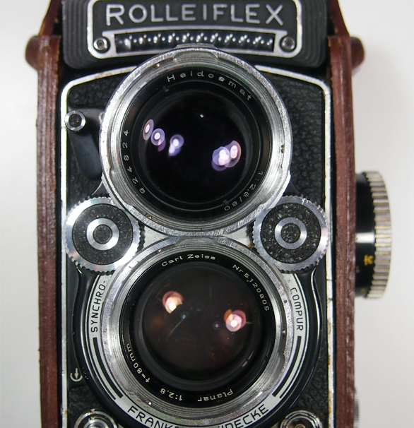 A Rolleiflex with a Carl Zeiss Planar 2.8 80 taking lens